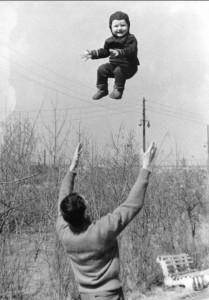 toddler thrown in the air